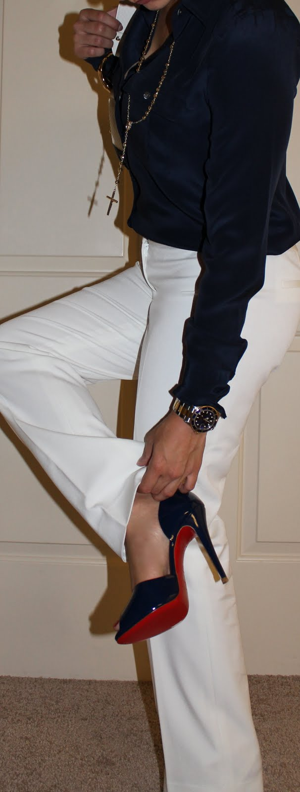 white pants and blue louboutins