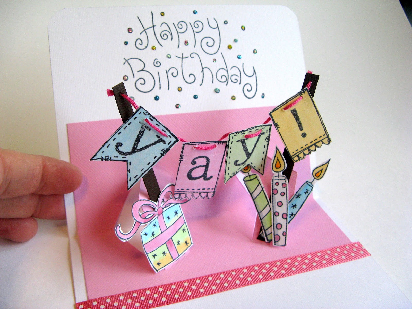 Elves in the attic yay its your birthday the posts fold into the middle when the card is closed and pop outward as its opened the trick to the mechanism is that the pop up is cut on kristyandbryce Choice Image