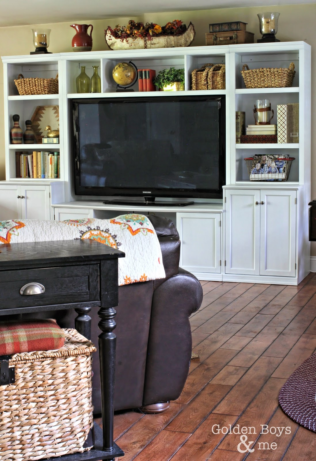 Painted wall unit with Rustoleum white spray paint in family room-www.goldenboysandme.com