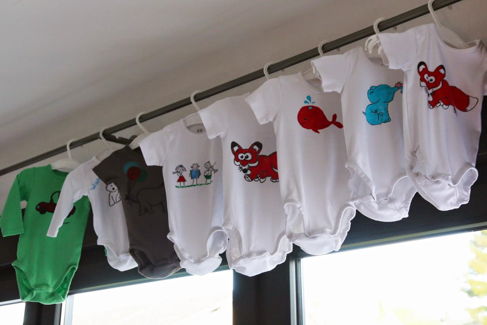 Stadtlandeltern - Babyparty - bemalte Bodys