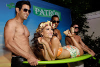 Maria Menounos on a green surf board