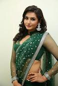 Ragini Dwivedi Glamorous photos in Green Saree-thumbnail-17