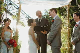 Loving looks between Juanita and Jon at the wedding ceremony at The Canal - Kent Buttars, Seattle Wedding Officiant