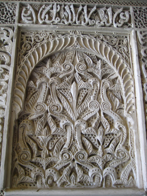 Carved stone wall in Casa de Pilatos in Seville, Spain.