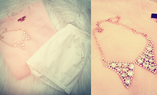 Pink angora sweater from H&M Lana del Rey with cream leather shorts and collar crystal necklace
