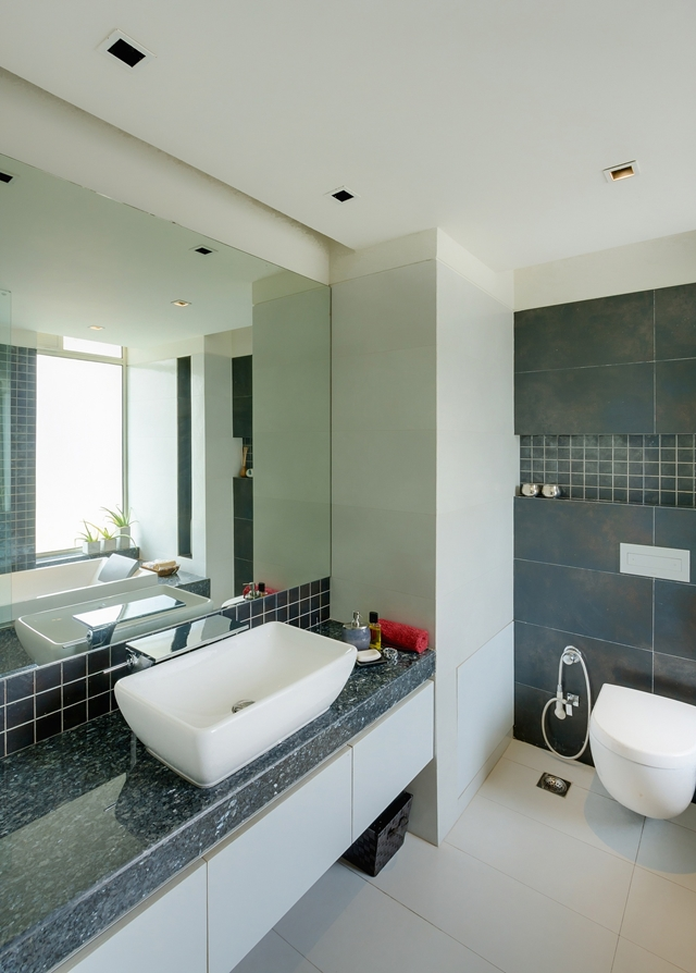 Picture of second bathroom with marble and white furniture