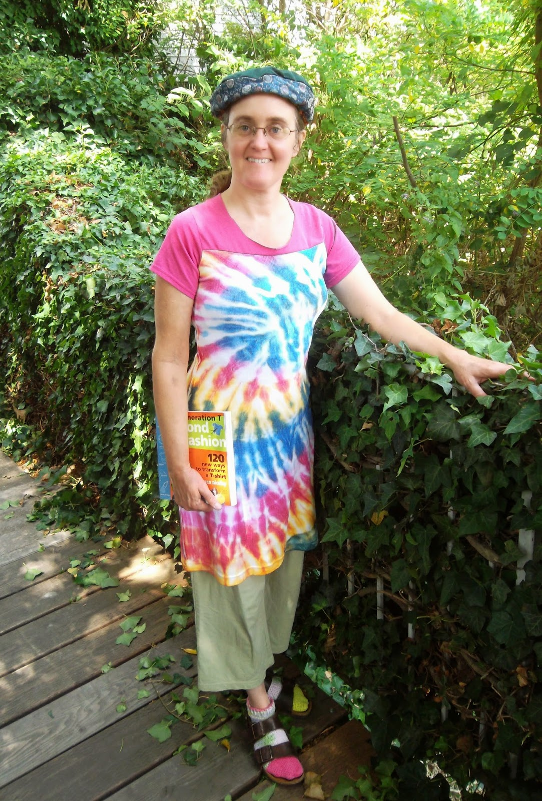 Cynthia M. Parkhill wearing tie-dyed dress, attached in a horizontal seam to the sleeves and neck of a hot-pink T-shirt.