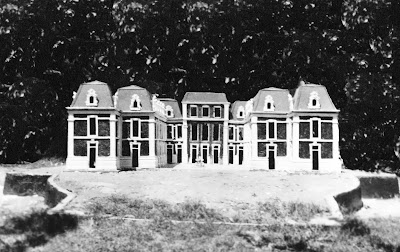 b/w image of Versailles model with mansard roofs in place.