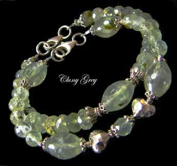 Stacking bracelets of green rutilated quartz