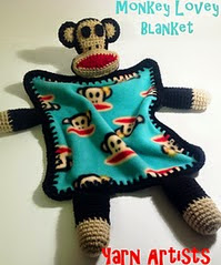 http://www.ravelry.com/patterns/library/monkey-lovey-blanket--paul-frank-julius-inspired-pattern