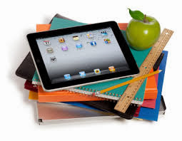 School supplies with an iPad on top