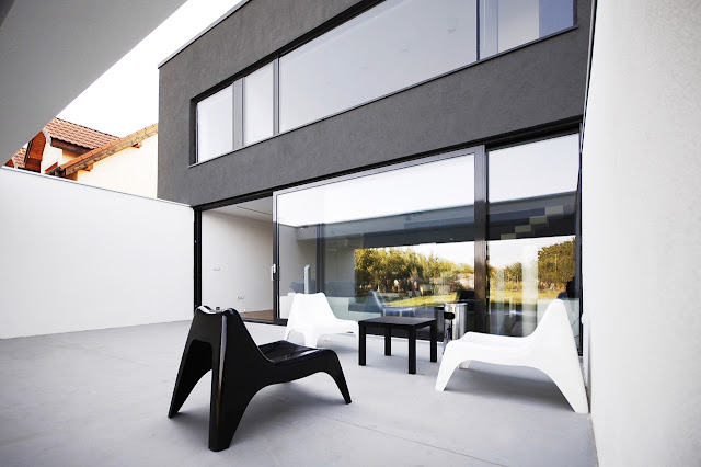 Back and white chairs on the terrace