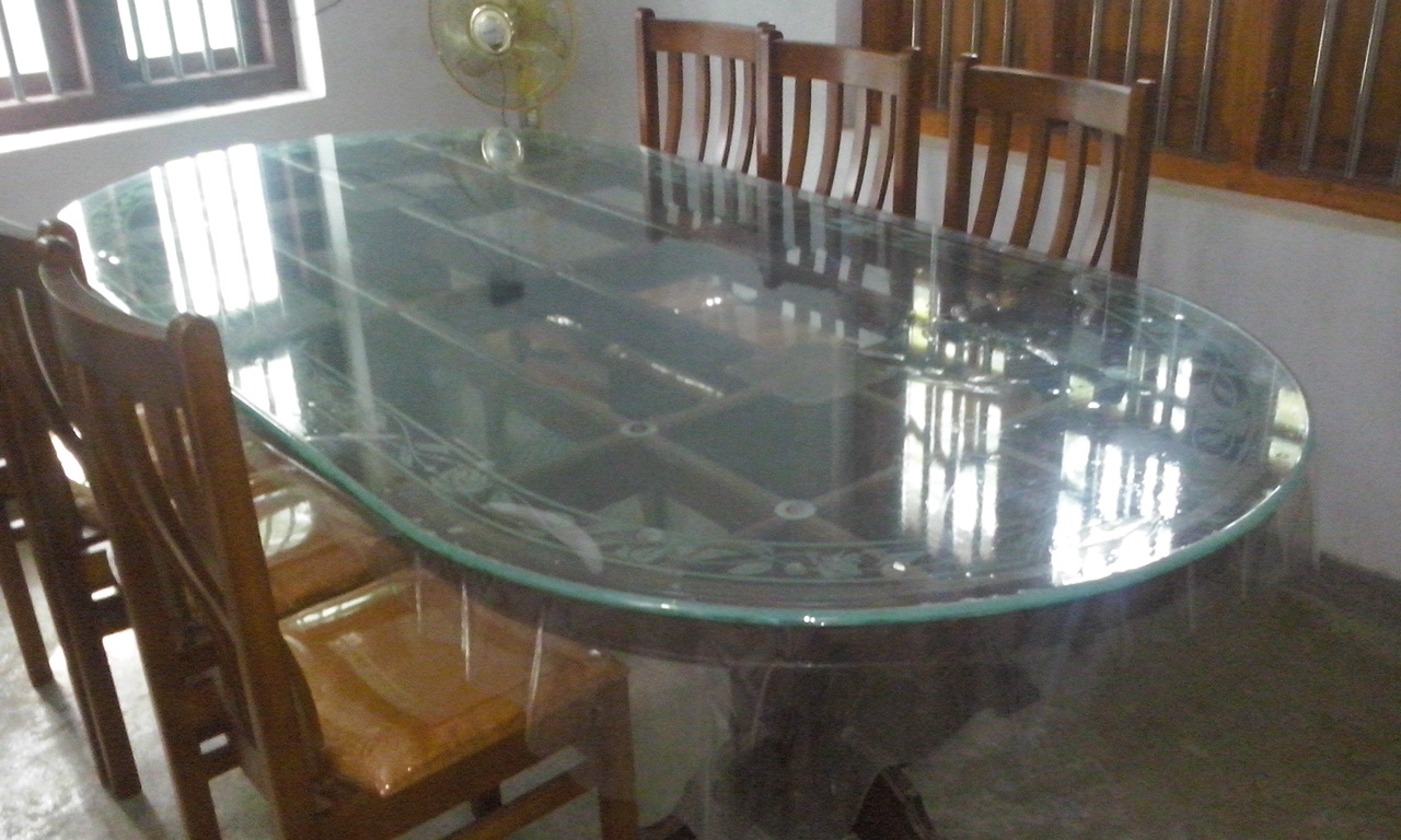 Kerala style carpenter works and designs wood dining for Dining table set latest design