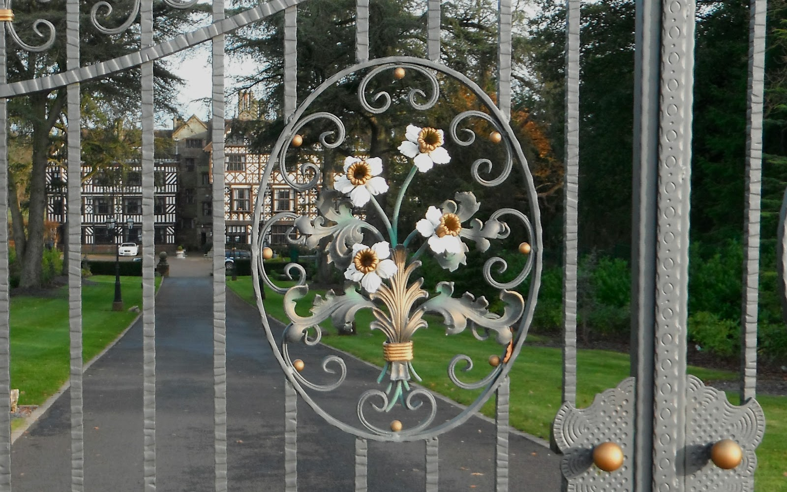 Broughton Hall gates with daffodils