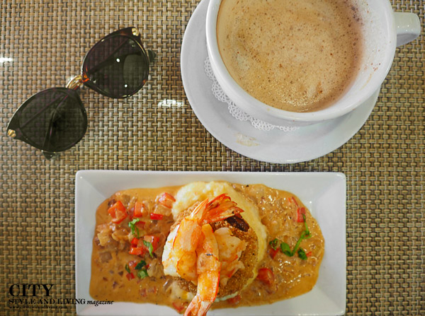 An absolutely lovely and creamy shrimp and grits and cappucino at Croissants Bistro and Bakery
