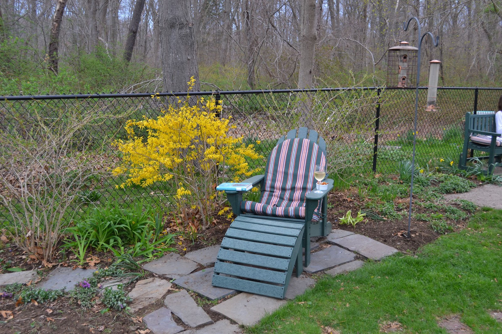 After a couple of hours of work I treated myself to a half hour of reading   sweet potato chips and a glass of wine in my favorite garden spot. Sacred Ordinariness  April 2011