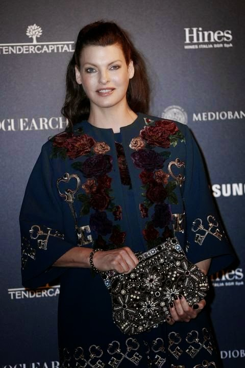 Oh my, Linda Evangelista looks amazing. . . . . .We do have massive lady crush on her so are a simply ethereal but who can deny how fantastic she looks here. And the 49-year-old was smoking gorgeous as she shows up to the Vogue Italia's 50th anniversary in Milan, Italy on Sunday night, September 21, 2014.
