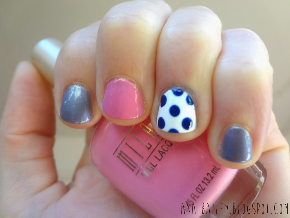 Blue and pink nails with polka dot accent nail