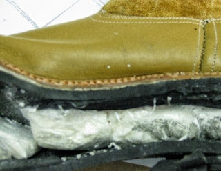 Dr. Drake discovered drugs hidden in the sole of a boot.