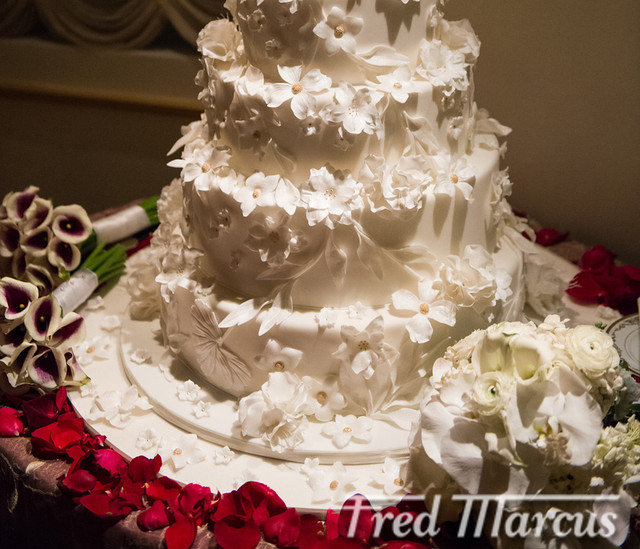 We Created This Six Tiered All White To Reflect The Season Custom Wedding Cake With Gold Accents Match Ballroom Main Decorations Were