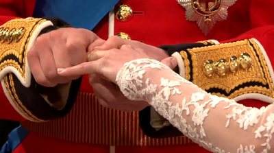 Prince William struggling to slide the wedding ring into Catherine's finger. YouTube 2011.
