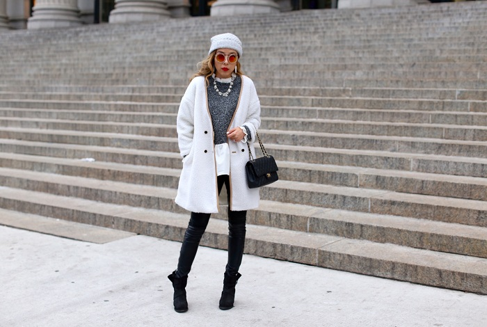 She in white long sleeve faux fur coat, she in white grey colorblock ruffle blouse, chanel classic flap bag, cat footwear boots, baublebar necklace, rayban sunglasses, blank denim moto pants, nyc street style, fashion blog, winter fashion, Kendra Scott Earrings