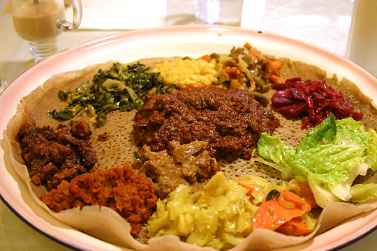 The walking cookbook ethiopian feast the 5 recipes whew ethiopian food is served on a piece of injera with many dishes to try forumfinder Images