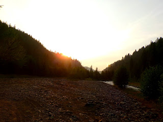 Pictures from the Idaho Mountains; sunset over mountains near a river. Night Sea 90.