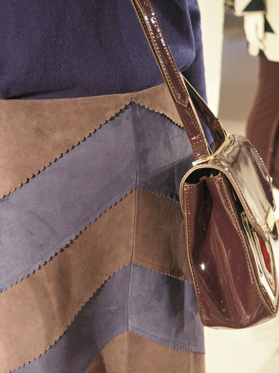 Jasper Conran for Debenhams outfit details. Brown and navy suede skirt and patent satchel bag