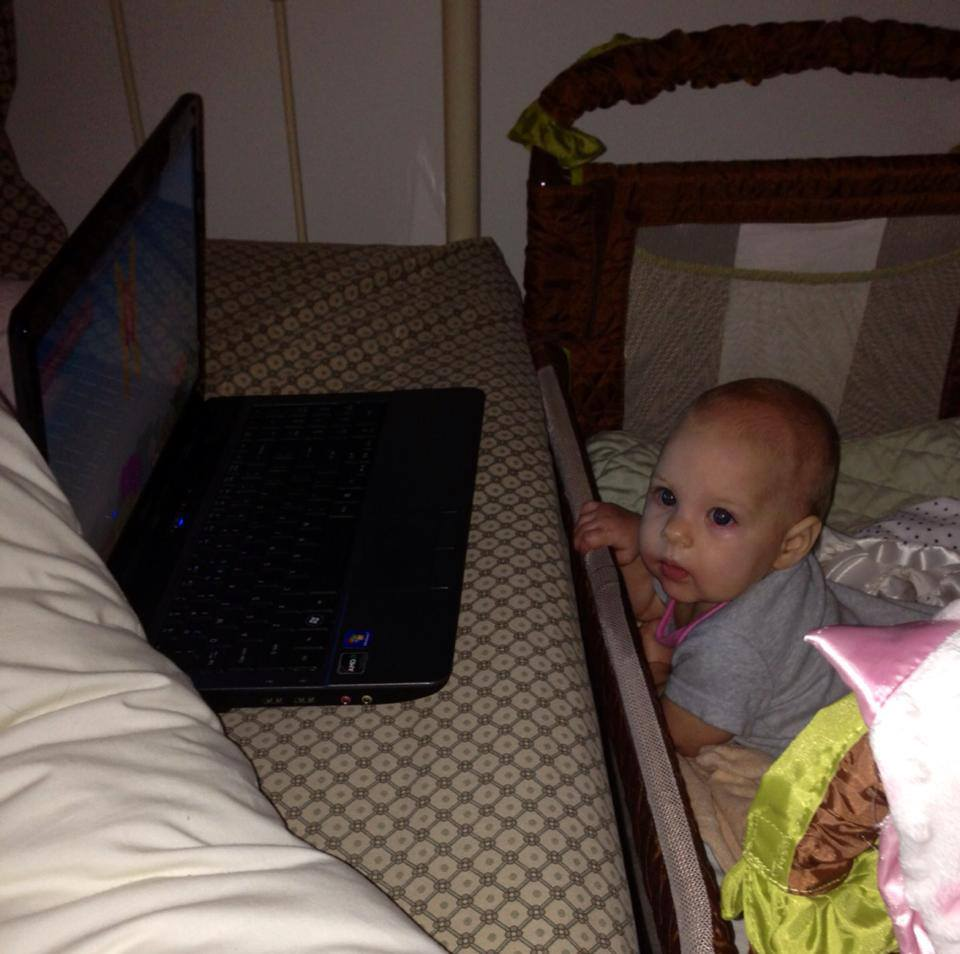 Watching nursery rhymes on my laptop from the co-sleeper!