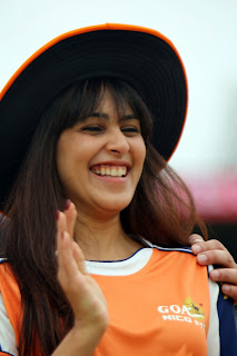 Genelia Spotted in Orange Shirt at CCL4 Cricket Matches with her Husband