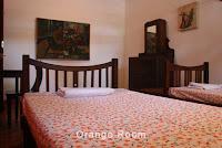 orange bedroom homestay