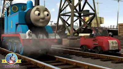 The Fat Controller sea docks Winston the red railcar next to Thomas the train and Cranky the crane
