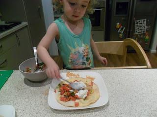 Adding yoghurt to chicken fajita tostadas