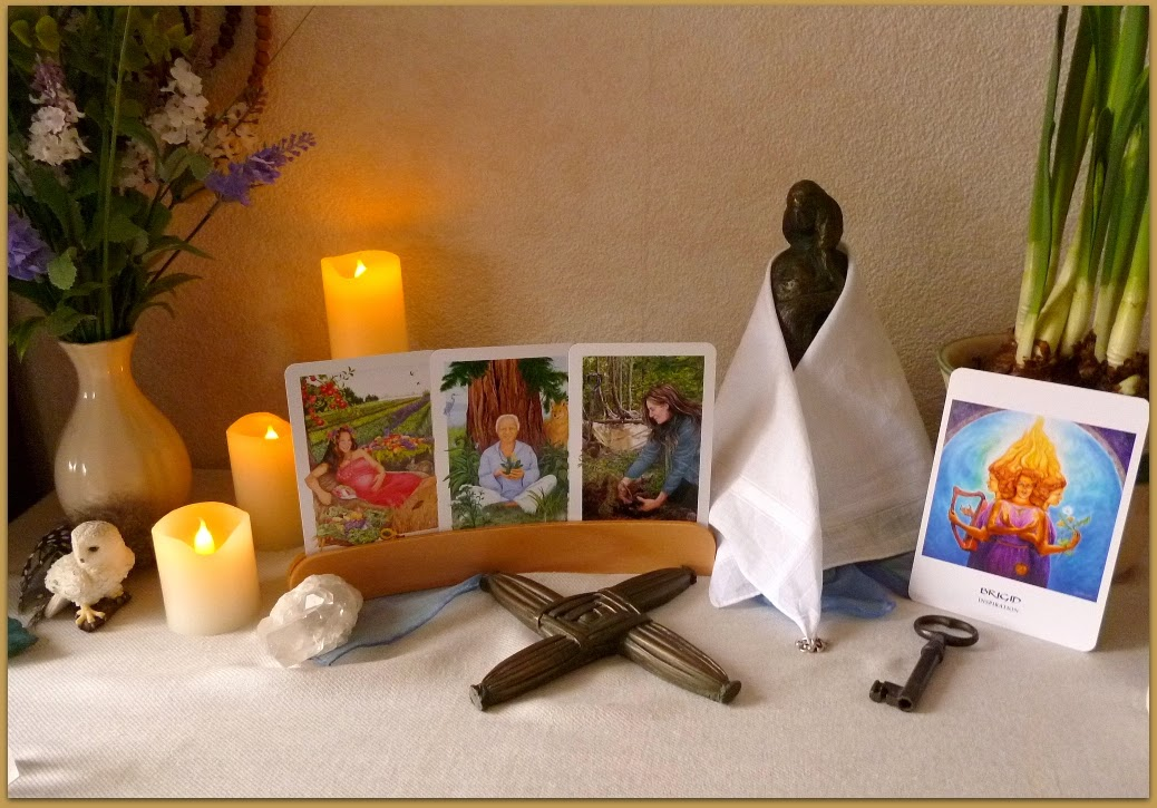 Brigid, Brat Bride, cloak .Imbolc Altar,  Gaian Tarot, The Empress, The Teacher. Seven of Earth