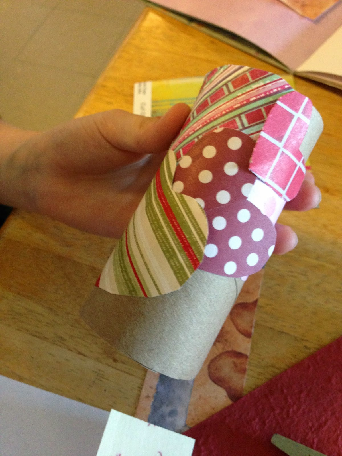 covering a toilet paper tube with paper hearts