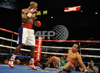 Floyd Mayweather, Jr. knocking down Juan Manuel Marquez