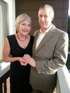 Chip and Jan holding hands on the balcony of their Salish Lodge room - Ceremony officiated by Patricia Stimac, Seattle Elope
