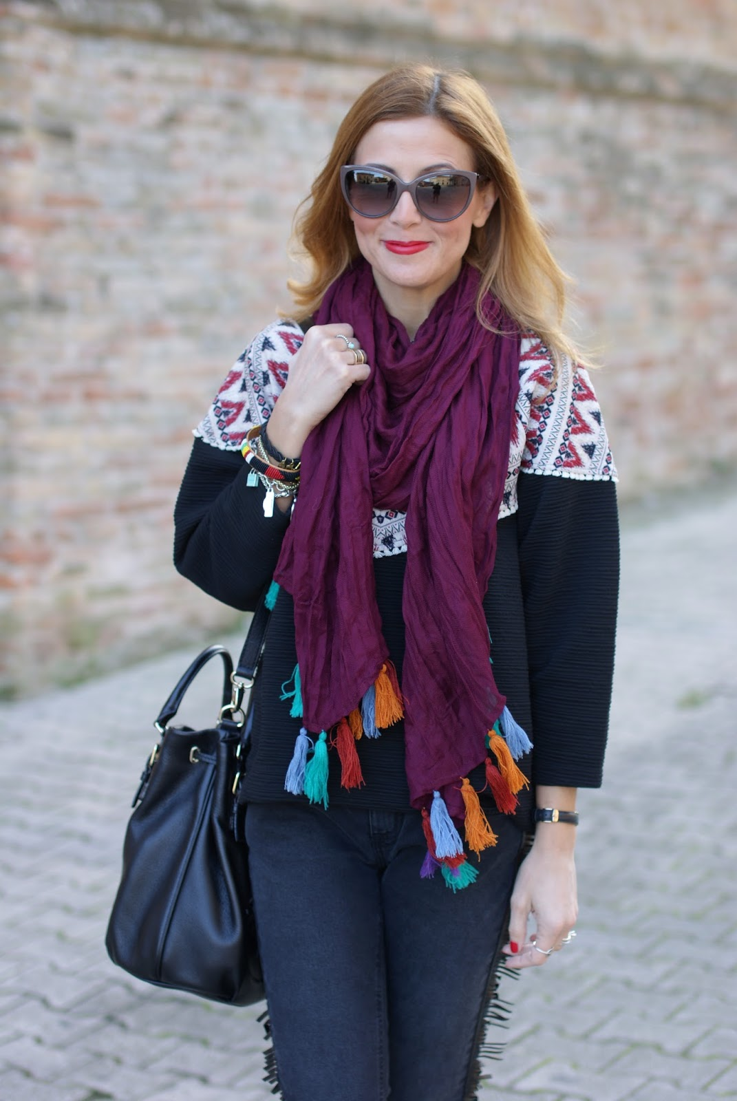 Fringed jeans and tassel scarf for an ethnic chic casual look on Fashion and Cookies fashion blog, fashion blogger style