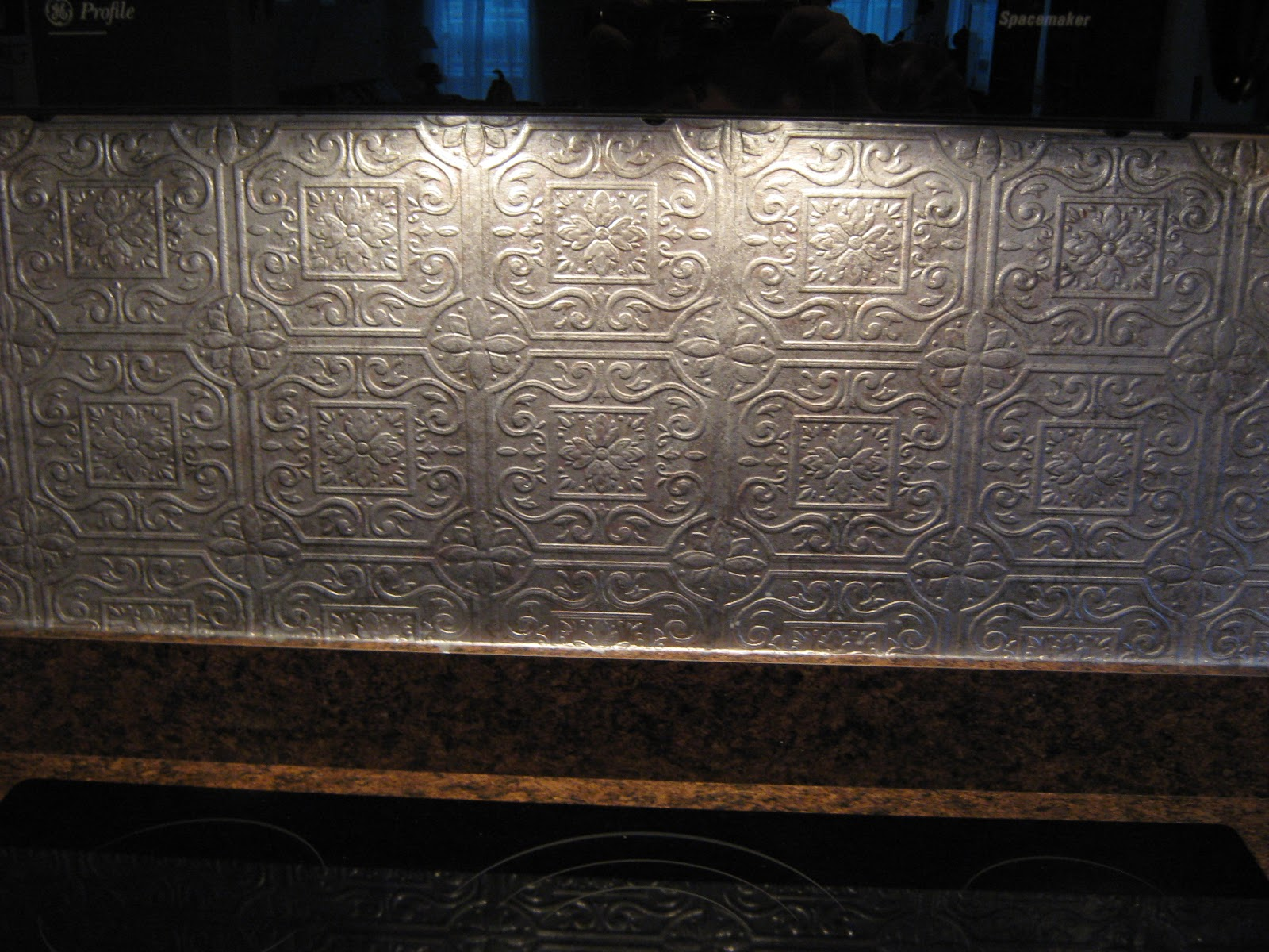 fake it frugal fake punched tin backsplash