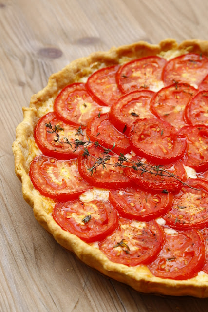 Tomato tart on a wooden background