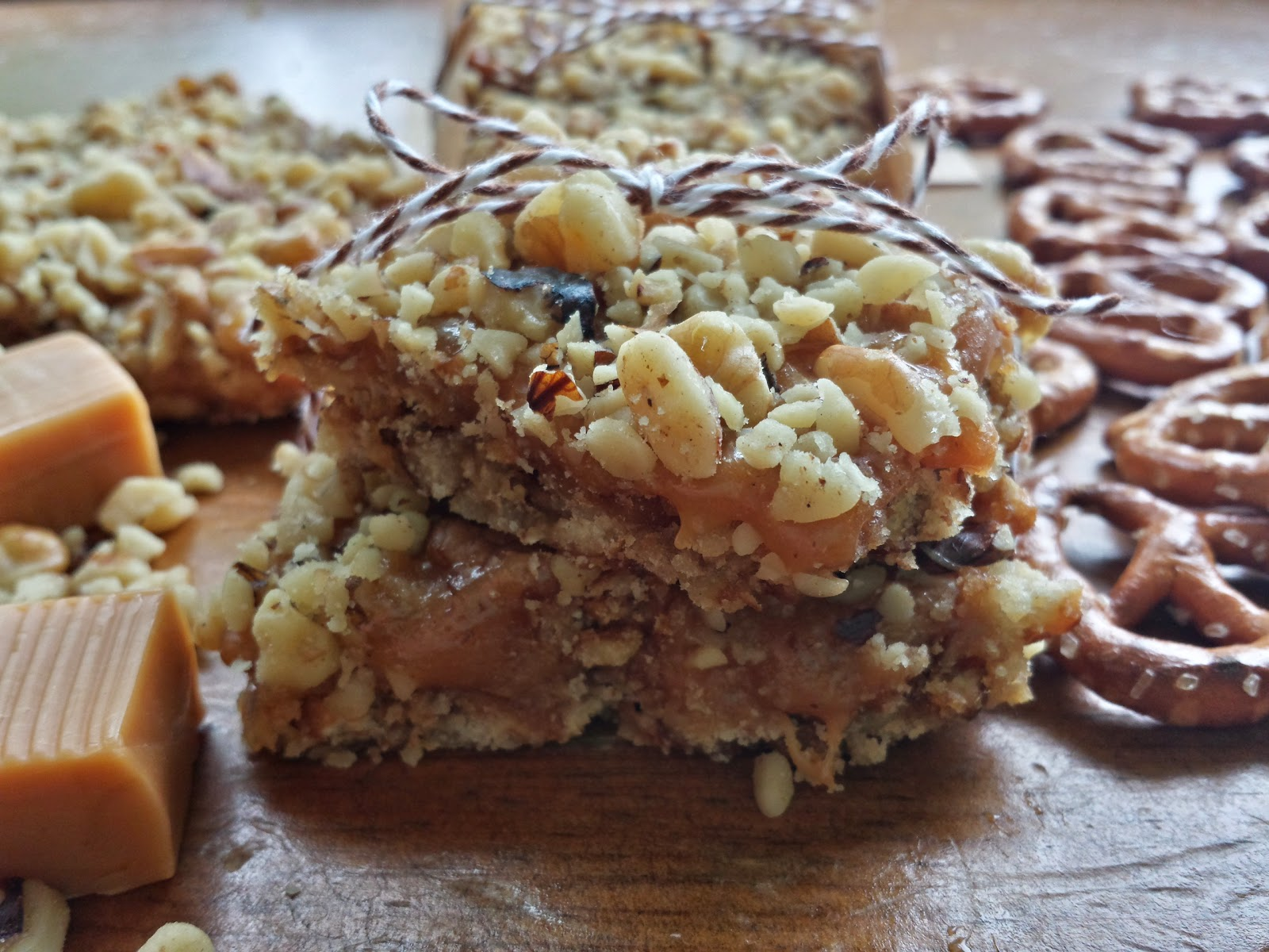 caramel walnut bars with caramel and pretzels