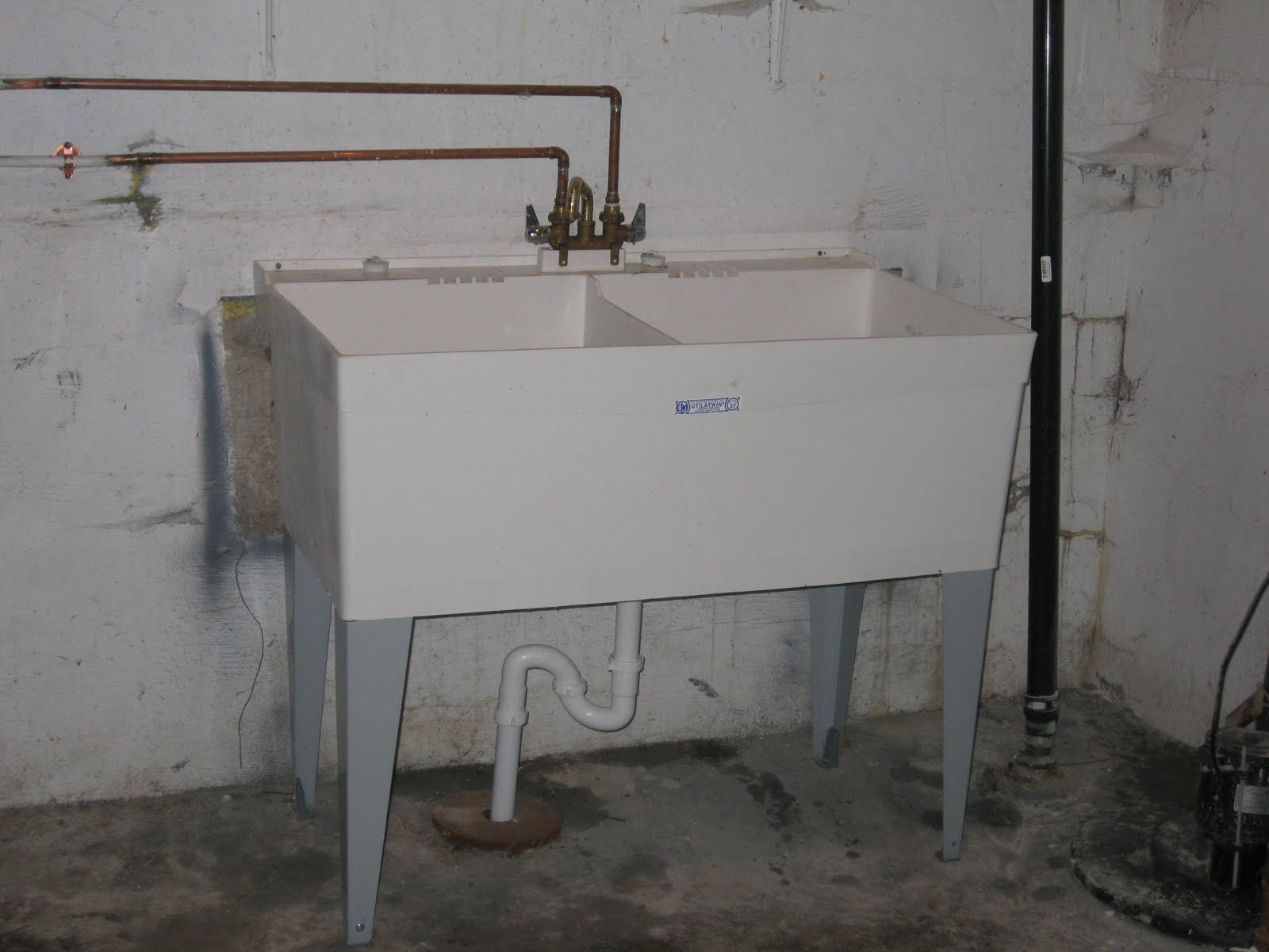new laundry sink in the basement as well