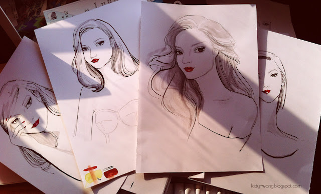 finished stack of ink portraits paper displayed fanned out. fashion girls illustration