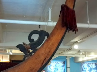 dog decoration on stern (?) of Solomon Island canoe at Peabody Museum