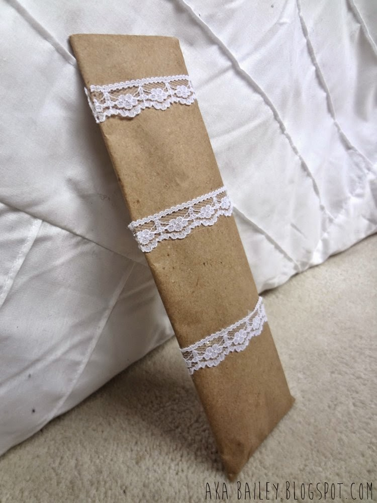 Brown paper gift wrap wrapped with lace trim