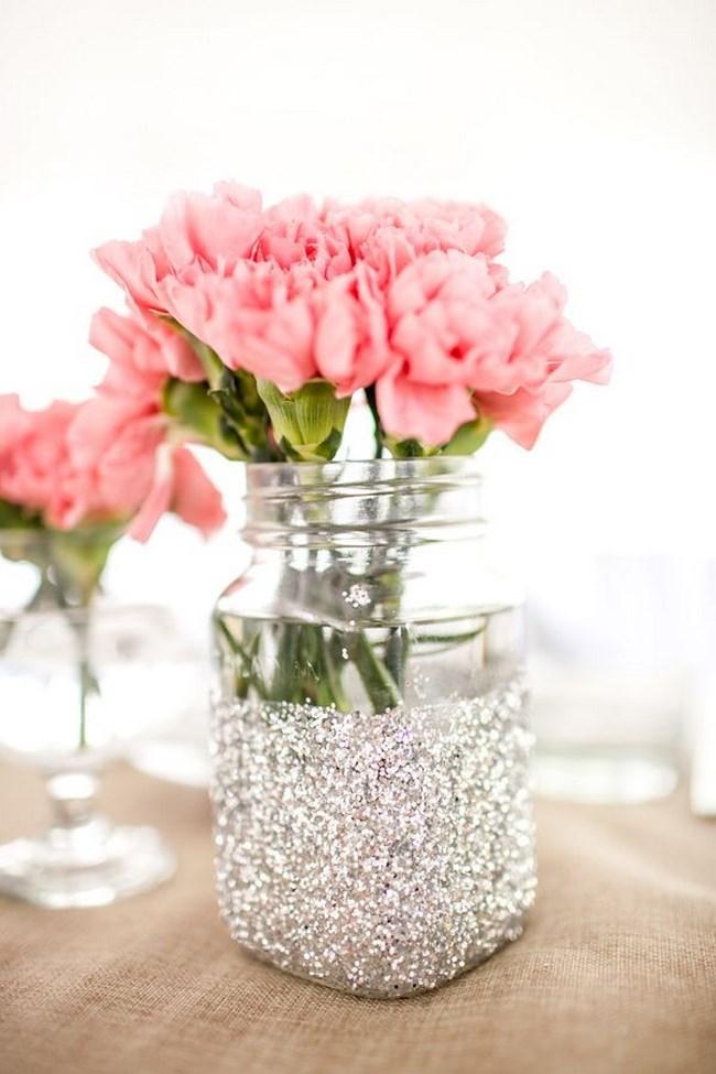 centros de mesa con recipientes de vidrio