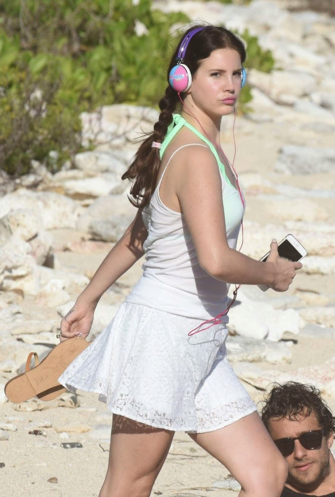 Lana Del Rey covers up green bikini with a white dress on St. Barts beach