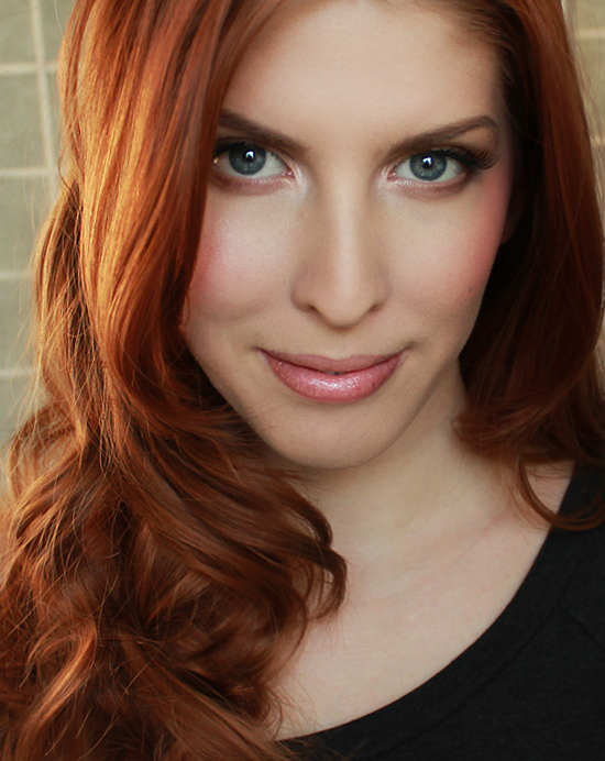Natural redhead with green eyes