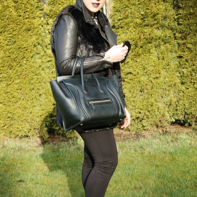 Black Simply Vera Wang faux fur vest, Mackage Kenya leather and a Celine Mini Luggage handbag.